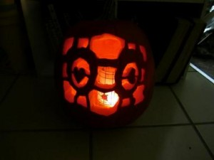 The Companion Cube carved into a pumpkin